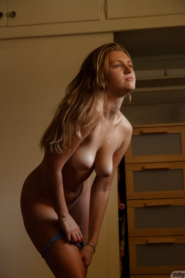 Tanned fitness girl Tatiana Penskaya strips naked and shows off her shaved pussy